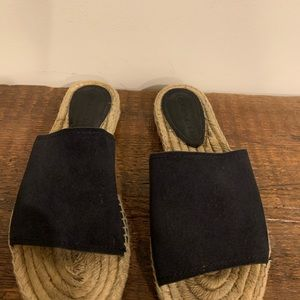 Coach sz 8 flat slip on sandal. Black suede upper